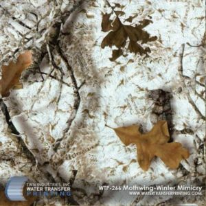 Mothwing Winter Mimicry™ is a winter camouflage that features a white moth wing background with wooded and leaf elements in the foreground. Mothwing™ patterns utilize the same design and camouflaging mechanisms as a moth's wing.